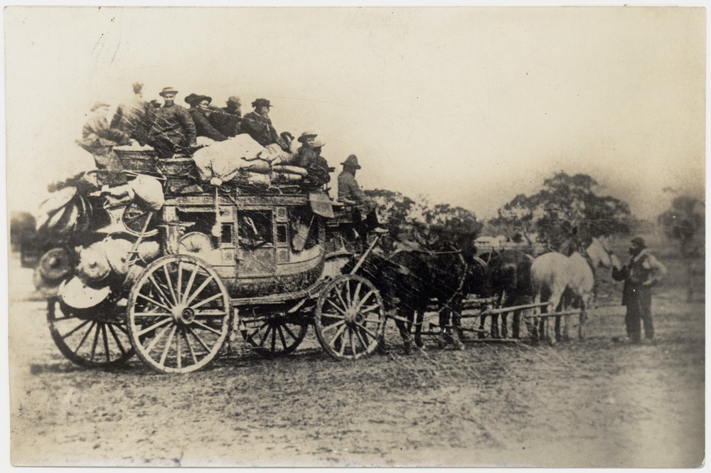 Imported Concord stagecoach, photographed in 1853 at Castlemaine, Victoria, Australia. The coach is packed with equipment with Chinese passengers inside and on top of coach leaving for the diggings.