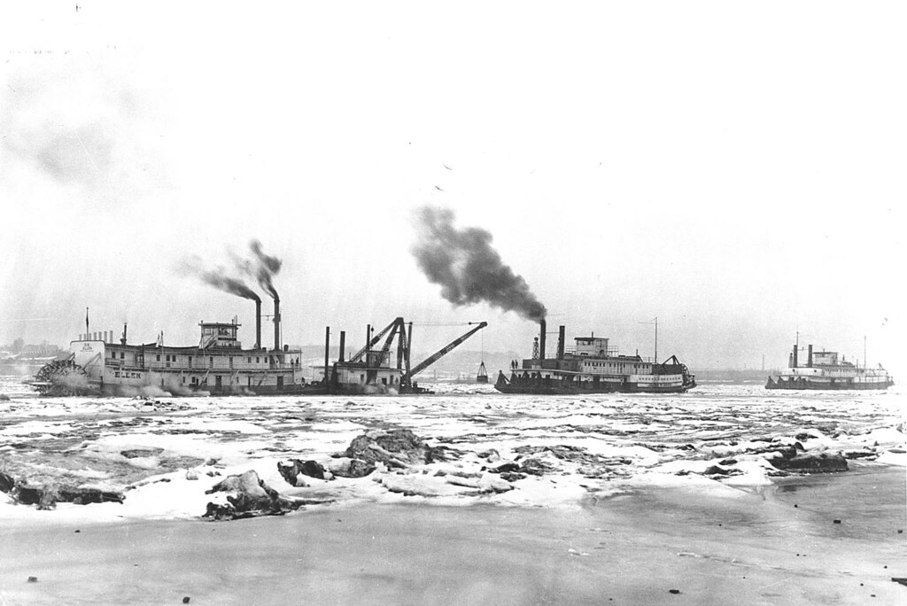 Ellen (Sternwheel towboat, 1907-1944, Mississippi River) BUILT 1907 at La Crosse, Wisconsin. On the left, in ice on the river the Ellen. In the middle is the Federal Barge Line towboat, the John W. Weeks.