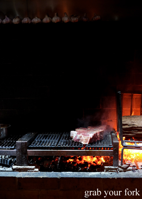 Cooking bistecca alla fiorentina t-bone steaks over oak and charcoal at Bistecca Sydney