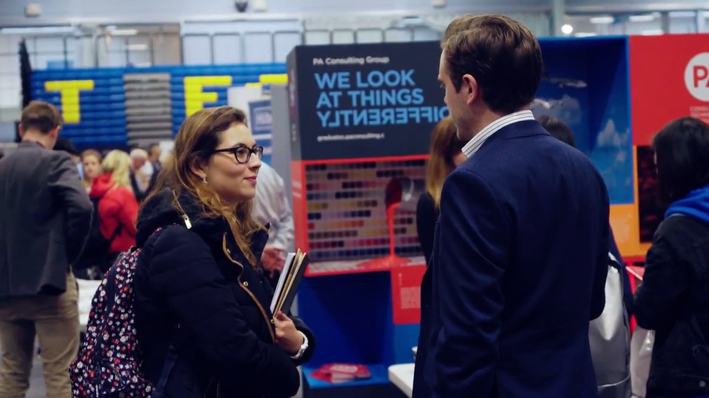 Student speaking to employer at a previous Fair