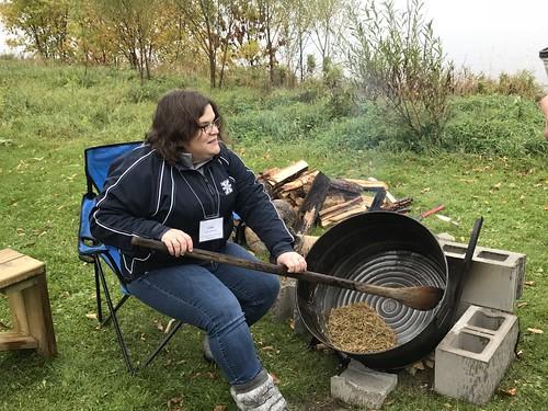 <p>St. FX Professor Lisa Lunney Borden learning how to harvest wild rice</p>