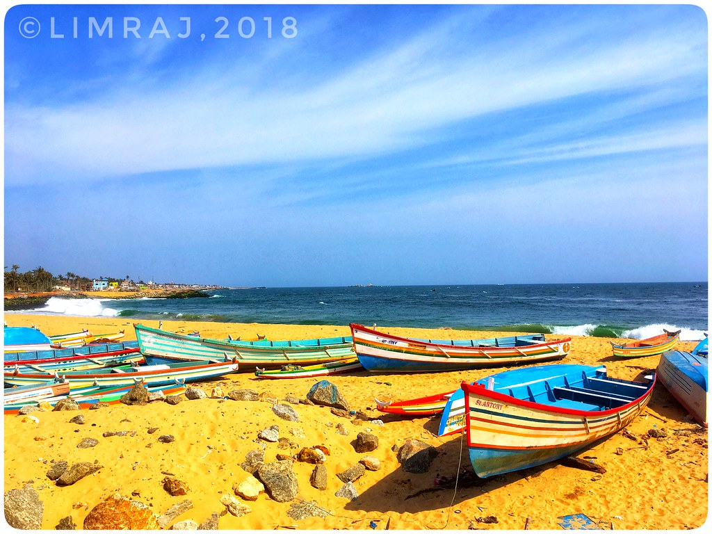 Boats sunbathing at Thengapattanam beach, TN, IN