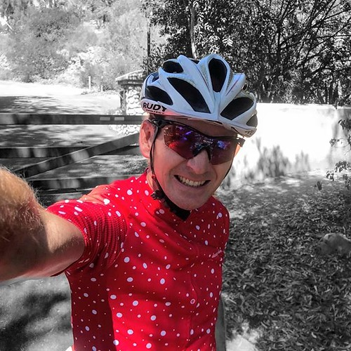 Even without Google adding color pop, this red jersey is bright in the group ride.