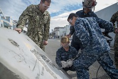 Sailors from USS Bonhomme Richard (LHD 6) chisel a concrete slab as part the annual Defense Support of Civilian Authorities (DSCA) full-scale exercise during San Francisco Fleet Week. (U.S. Navy/MC2 William Sykes)