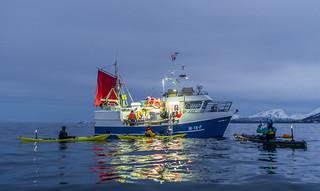 Chatting up fishermen at work, outside Skjervøy