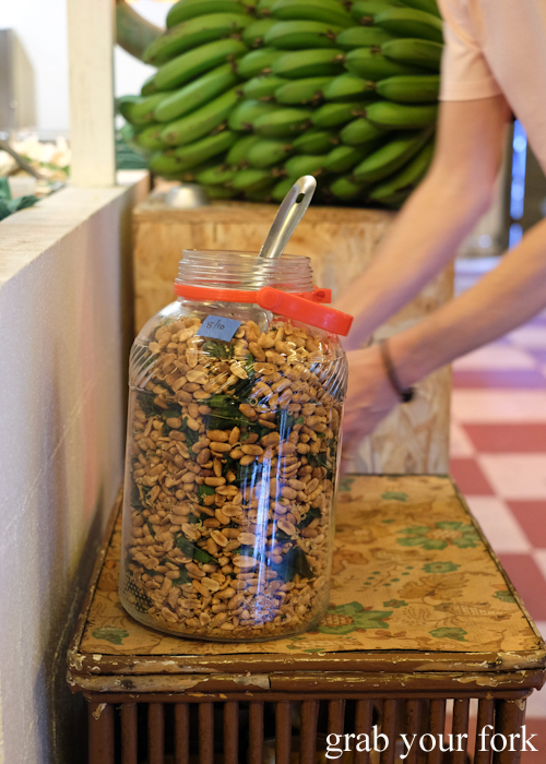 Giant jar of sa nte k'dei Cambodian kaffir lime and chilli peanuts at Kingdom of Rice in Mascot Sydney