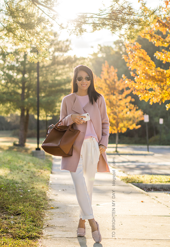 pink wool open front draped jacket, pink cashmere sweater, white crepe ankle pants, brown tote, light pink loafers