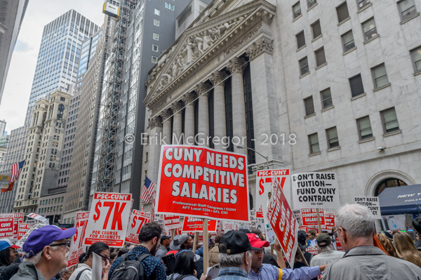 CUNY professors' union march on Wall Street to demand fair contracts