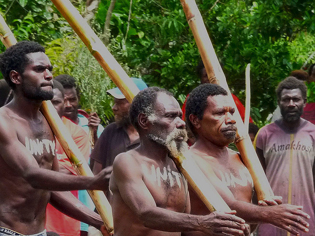 Tannese from the John Frum cult doing mock military drills with lengths of bamboo fashioned as rifles  in Vanuatu