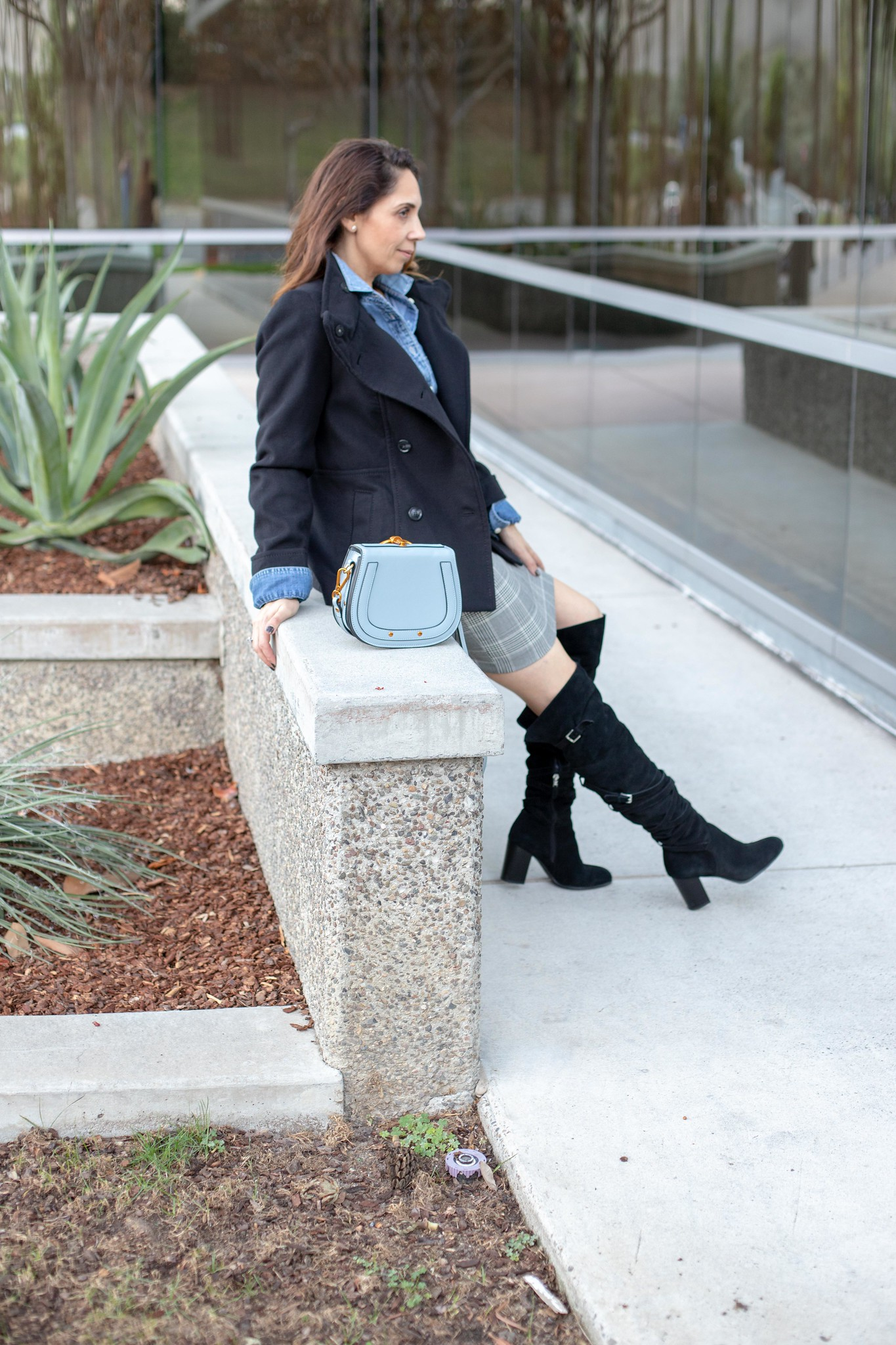 over the knee boots and black coat