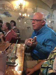 John Acorn singing the Nature Nut theme song on a ukulele at the steak pit in Patricia!!