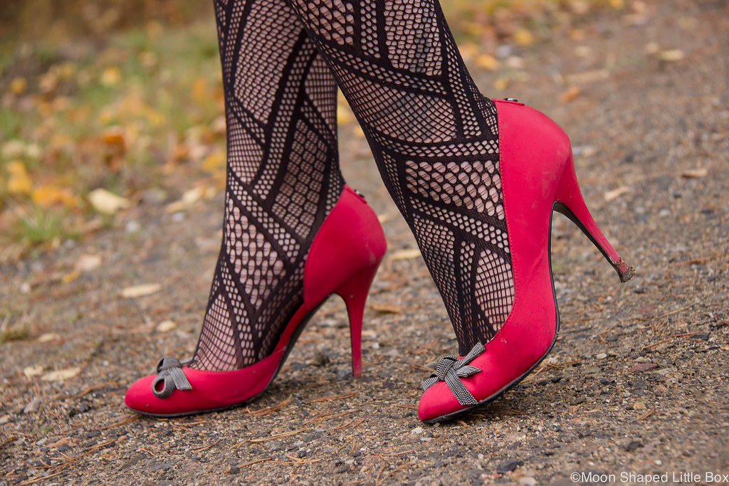 Guess, satin heels, fishnet stockings