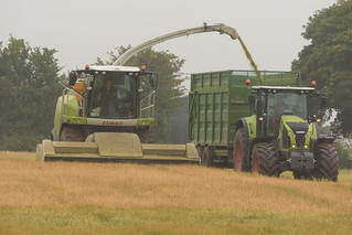 Claas Jaguar 870 SPFH filling a Broughan Engineering Mega HiSpeed Trailer drawn by a Claas Axion 800 Tractor