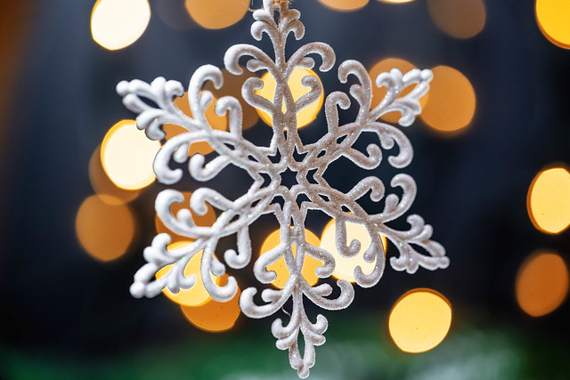 Beautiful snowflake on the background of Golden bokeh