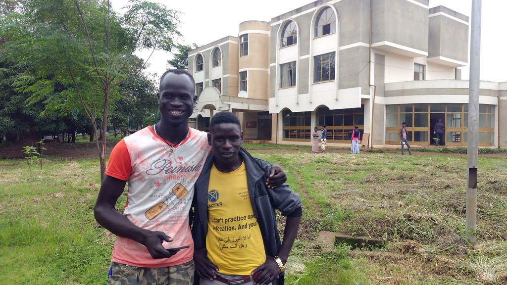 South Sudanese refugees and current college students, Poch Jackson Petov and Hamid Abdallah Hamad in front of Gilgel-BelesCollege of Teacher Education. © UNICEF Ethiopia 2018 Amanda Westfall