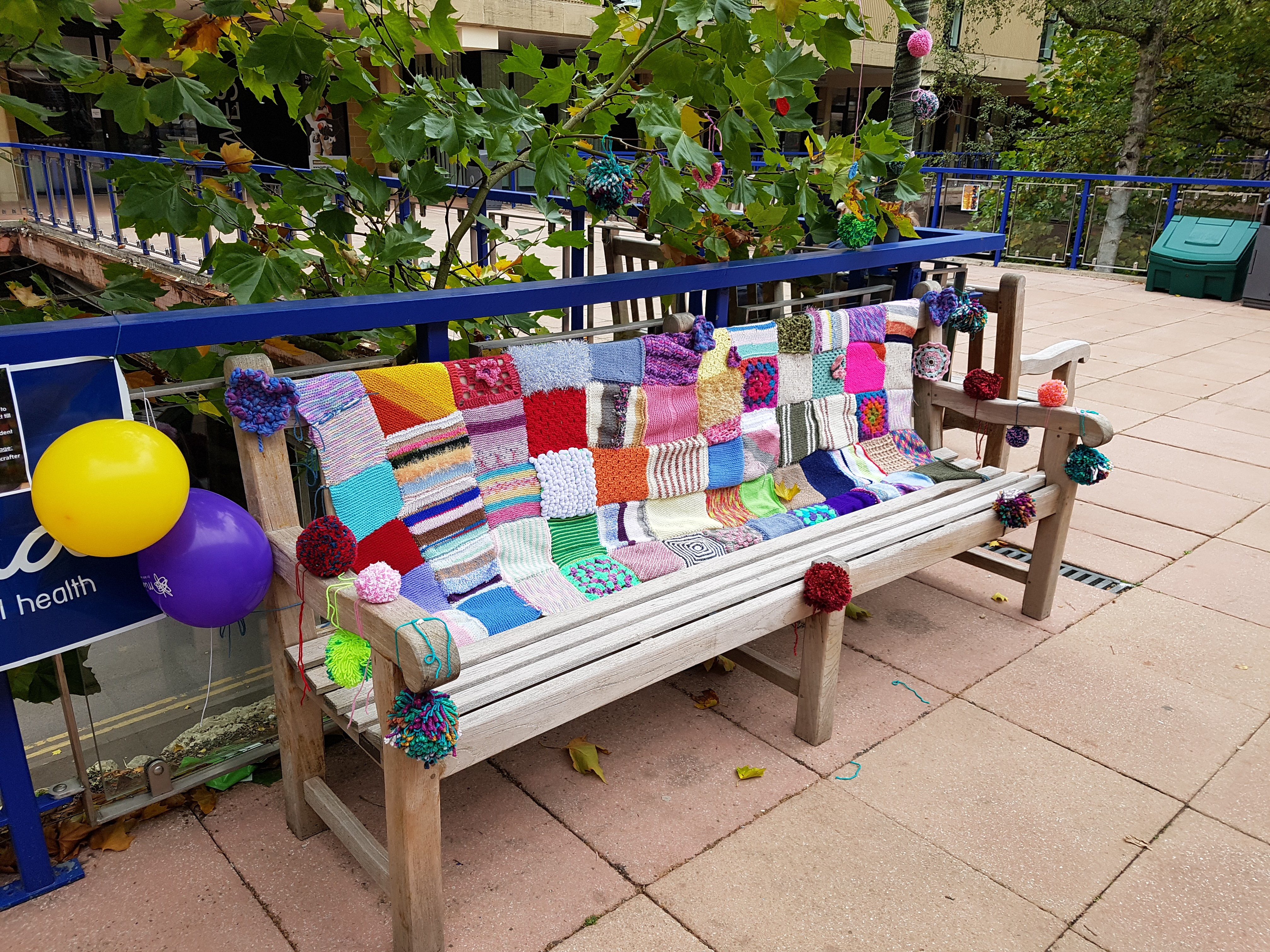 A bench covered in woollen squares