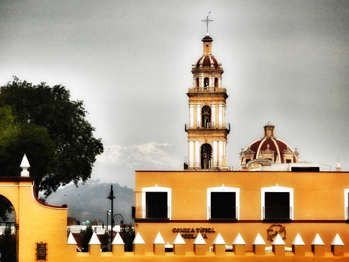 One of the yellow churches in Cholula, Mexico, run through the photo app Snapseed