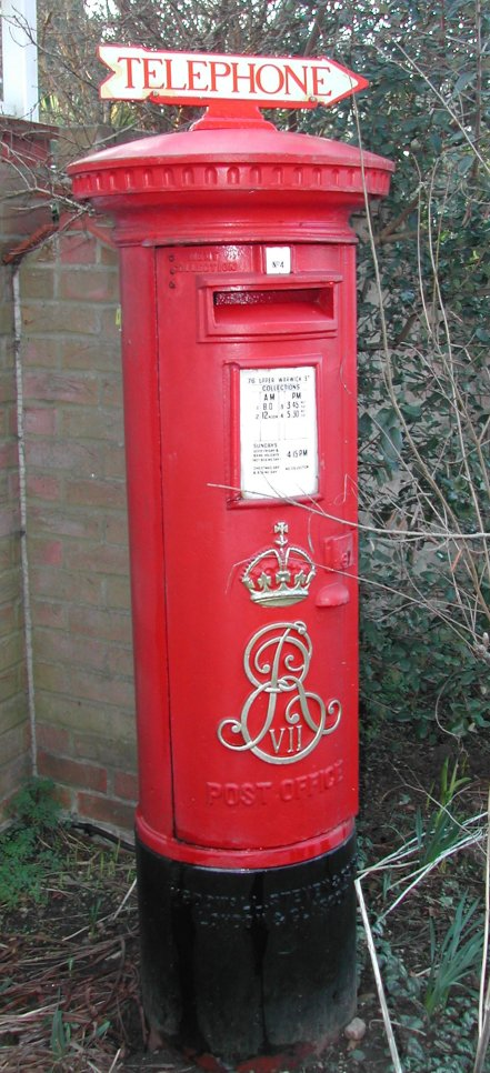 Edward VII post box with aperture on door, post 1905, fitted with rare Telephone Direction sign at Colne Valley Postal History Museum, Halstead, Essex.