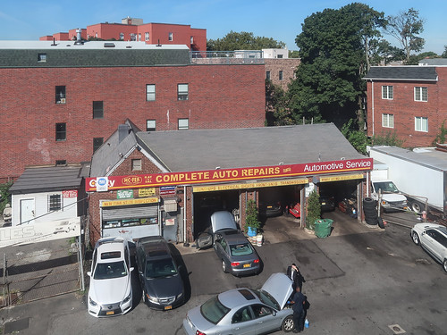 What a superb view of an auto repair shop in Brooklyn made of bricks.