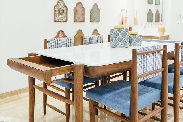 Teak wood dining table with storage for linen