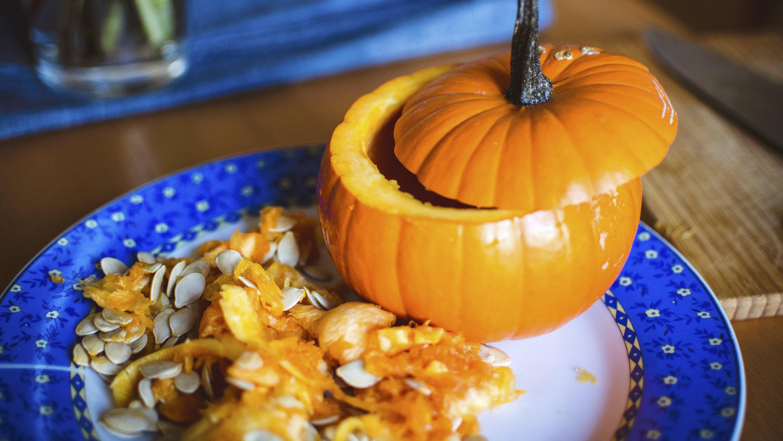 A cut pumpkin on a plate