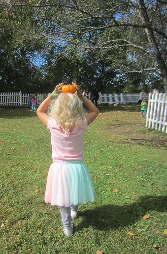 balancing a pumpkin