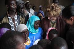 UNICEF Representative to Ethiopia, Ms. Gillian Mellsop and National ambassador to UNICEF Ethiopia, Tommy T. with children at  Homosha village,  in the Benishangul-Gumuz