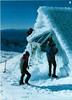 Tongariro National Park Rangers chiselling ice and snow off the solar panels which power the Dome Hut's emergency telephone (1986-7)