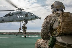PHILIPPINE SEA (Nov. 1, 2018) Sailors from Explosive Ordnance Disposal Mobile Unit 5 fast rope from an MH-60S Sea Hawk, assigned to Helicopter Sea Combat (HSC) 12 aboard the Royal Canadian Navy's MV Asterix during Keen Sword 19. Keen Sword 19 is a joint, bilateral field-training exercise involving U.S. military and Japan Maritime Self-Defense Force personnel, designed to increase combat readiness and interoperability of the Japan-U.S. alliance. ((U.S. Navy photo by Mass Communication Specialist 3rd Class Erwin Jacob V. Miciano)