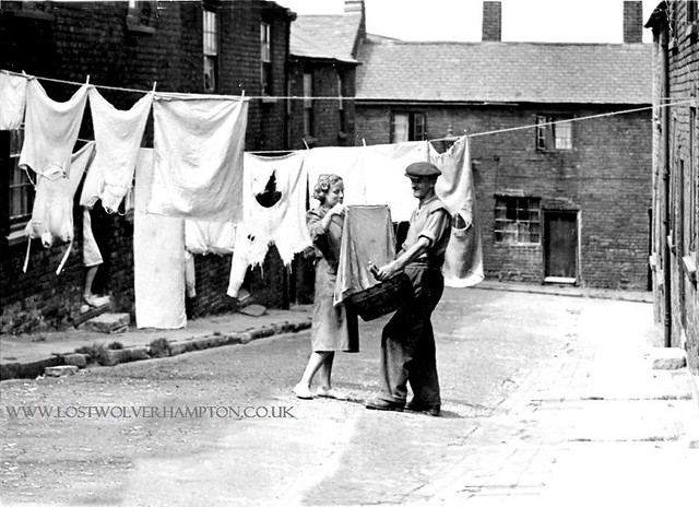 No standing on ceremonies! Whether it was rain or shine, the washing still got hung dry on Mondays in Lawyers Field. This was Mr. and Mrs. White, the family who lived next door to my aunt.