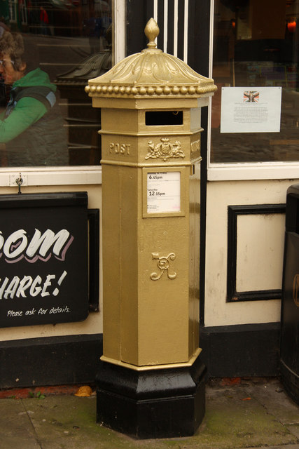 Gold-painted Penfold postbox in Castle Square, celebrating the Paralympic successes of Sophie Wells Photo taken by Richard Croft on October 1, 2012.