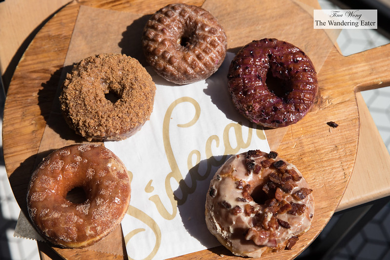 (From far left to right, clockwise) Apple Cider, Saigon Cinnamon Crumb, Vanilla Chai, Huckleberry Cake, Maple Bacon Doughnuts