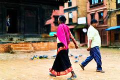 People walking near a Hindu Shrine in Bhaktapur, Nepal