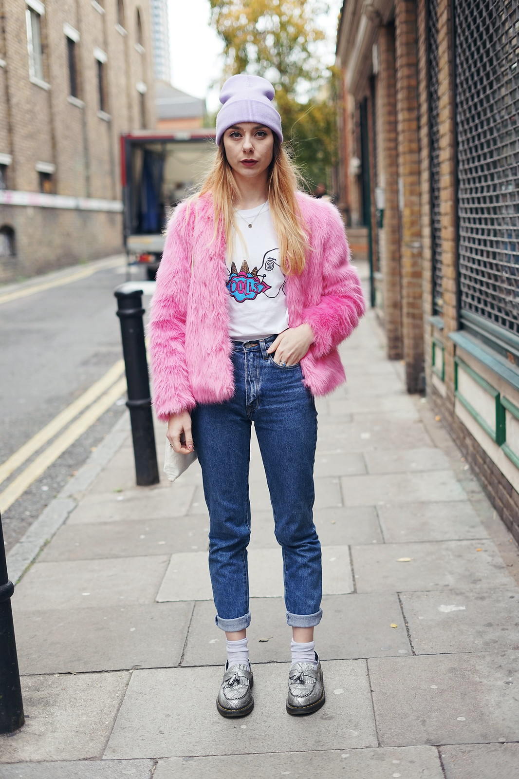 A band tee and a faux fur coat