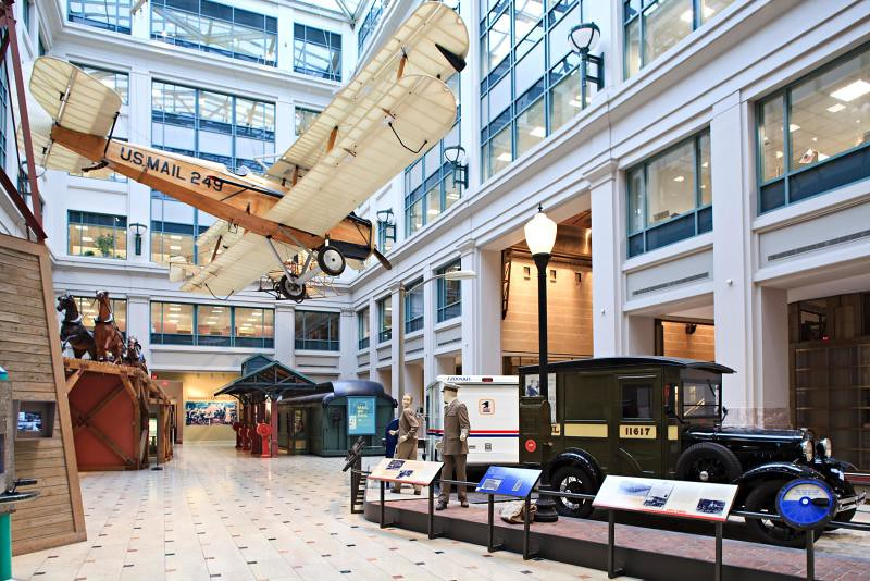 Moving the Mail exhibit at the Smithsonian National Postal Museum in Washington, D.C., featuring a Curtis Jenny airplane.