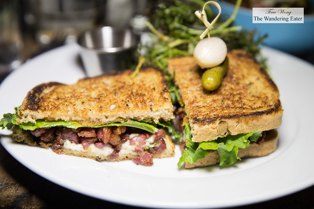 Lamb Belly BLT - toasted rye, rosemary aioli, crispy house cured lamb belly, mustard greens, spiced tomato
