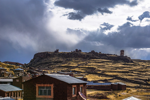 travel peru andes landscape nature altiplano mountains mountainside sillustani sky cloud settlement building atuncolla
