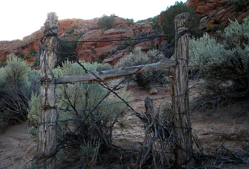 Tumbledown wire and wood fence at Coyote Buttes on our hike to the Wave on the Utah-Arizona Borderlands