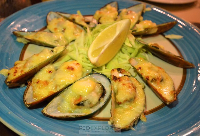city garden hotel makati encima roofdeck restaurant baked mussels