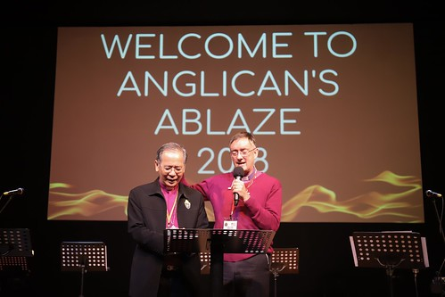 Anglicans Abalze 2018 - Bishop Martin prays for Archbishop Moon Hing