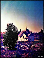 Church and Churchyard Cemetery - Evening view from ViaRail Canada window