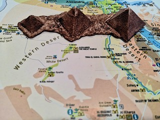 Great Pyramids of Giza figurines on a map of Egypt