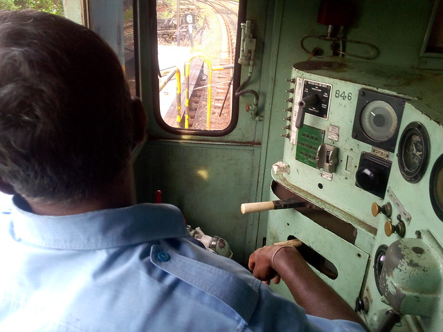 Sri Lankan train driver at the controls on the Coastal Line.