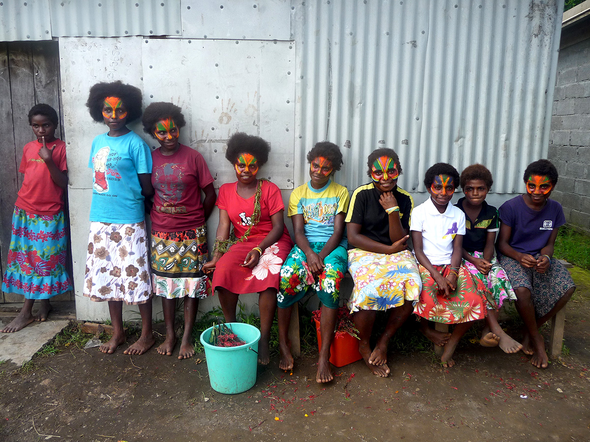Tannese girls in middlebush getting ready with face painting for  celebrations  where dancing and singing always forms an important part