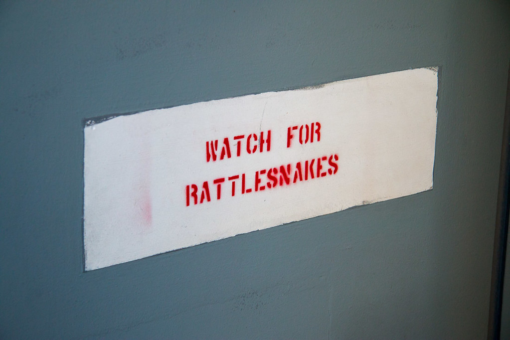 Sign that says watch for rattlesnakes