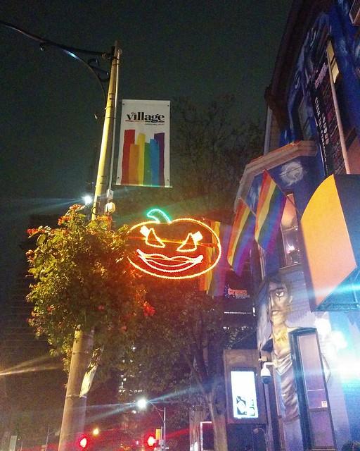 Halloween neon drag #toronto #churchstreet #churchandwellesley #halloween #neon #orange #lights #night #rainbow