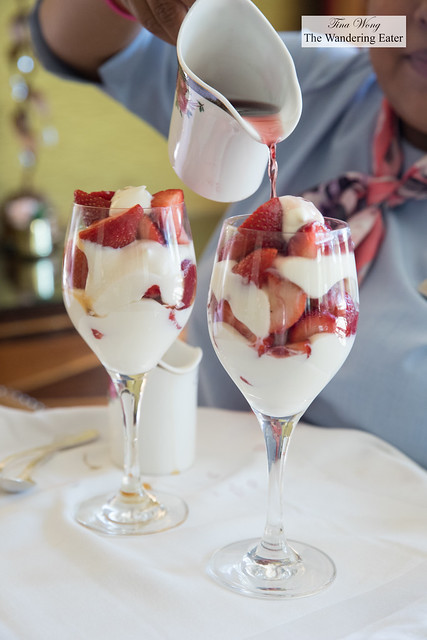 Strawberries and fresh whipped cream topped with Chambord (the other coupe was topped with Grand Marnier)