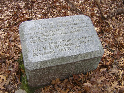 The site of King Philip's death in Miery Swamp on Mount Hope, Rhode Island. The inscription reads,