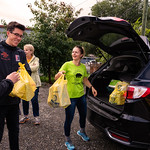 Calum Carrigan unloads donations (Sept 2018 Peter Olson photo)