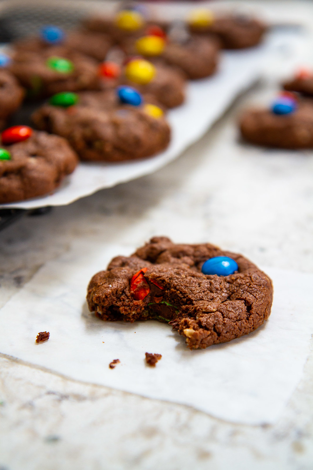 Brownie Monster Cookies -- Deliciously soft and fudgy homemade cookies with classic Monster cookie flavors, like peanut butter, M&Ms and oats! @girlversusdough #girlversusdough #browniecookies #easycookierecipe #dessertrecipe